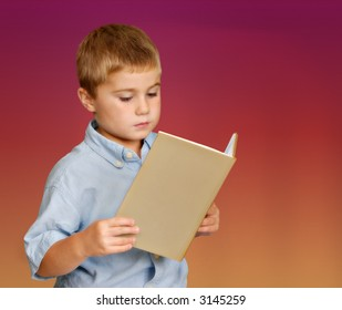 Young boy reading a book against isolated background