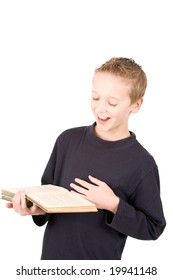 young boy reading a book and laughing