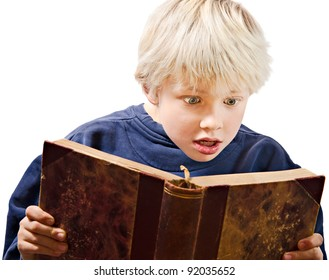 young boy reading excited in an old book
