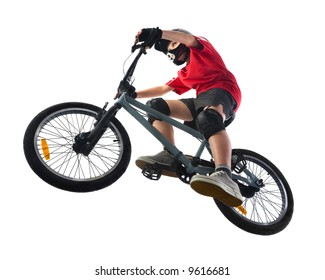 Young boy in red T-shirt cycling on BMX. Unusual angle view - directly below.