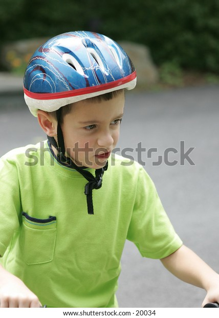 Young boy rider with helmet.