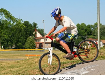 Young boy riding bicycle on a summer day