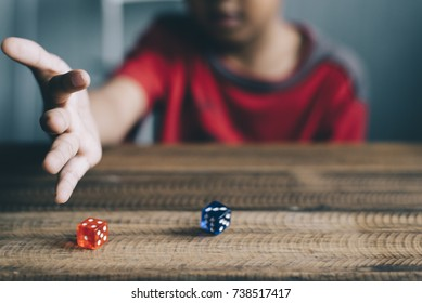 young boy rolling / throwing a dice