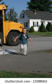 Young boy running off the school bus after his first day of school.
