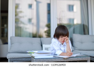 Young boy sad and crying feeling stress from difficulties homework alone with copy space