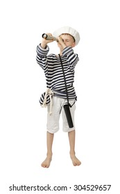 Young boy in sailor hat and frock looks through telescope isolated on white background - adventure and travel concept
