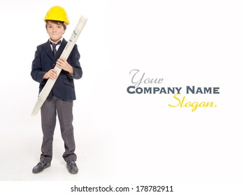 Young boy in school uniform wearing a yellow safety helmet and holding blueprints