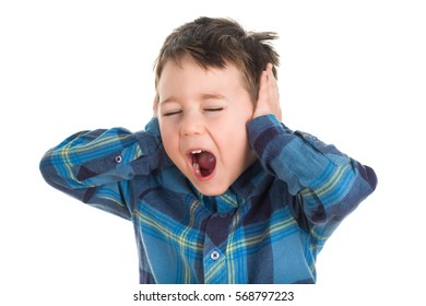 Young boy screaming and covering ears