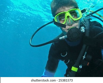 A young boy scuba diver all geared up