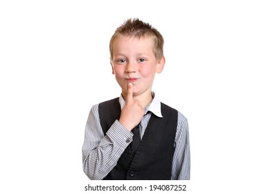 Young Boy in shirt and tie smiling at Camera in thought