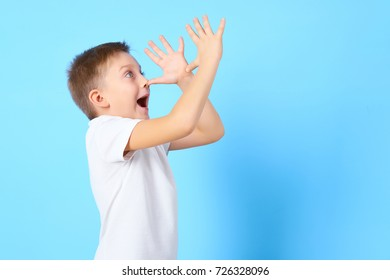 Young boy show different emotions in white t-shirt on blue background