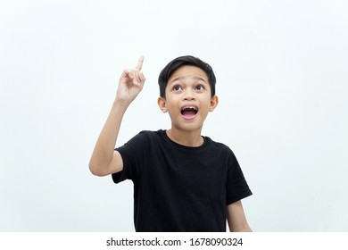 Young boy showing finger up gesture of getting ideas