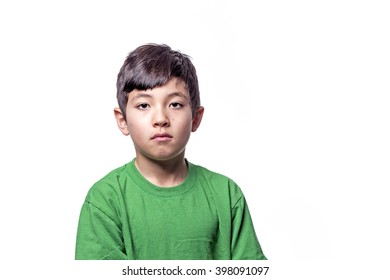 A young boy showing a sad expression on his face.