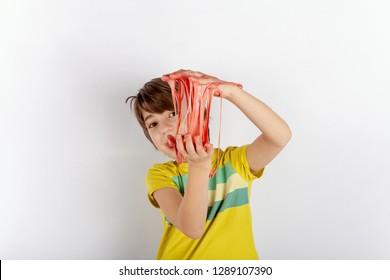 Young boy showing a  slime between his hands