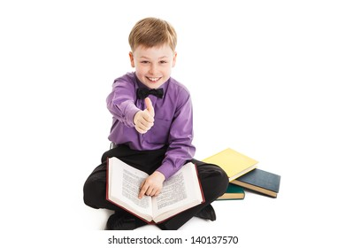 young boy shows thumbs up during a homework isolated