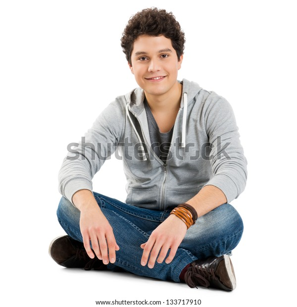 Young Boy Sitting Isolated On White Background