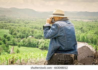 Young boy sitting looking nature