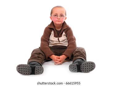 Young boy sitting on a white background.
