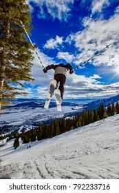 young boy ski jumping at Jackson Hole Resort, Wyoming, USA