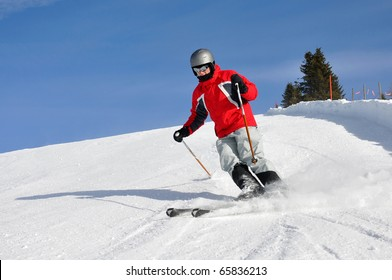 Young boy skiing on mountains in Austria