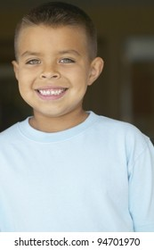 Young boy smiling for the camera