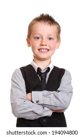 Young Boy Smiling at Camera with arms crossed