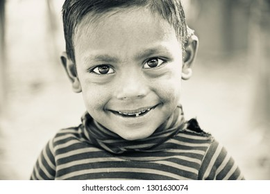 Young boy smiling isolated unique black and white photo