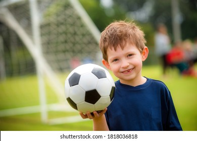Young boy with soccer ball before game