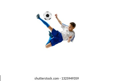 Young boy with soccer ball running and jumping isolated on white studio background. Junior football soccer player in motion