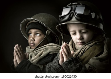 Young boy soldiers praying