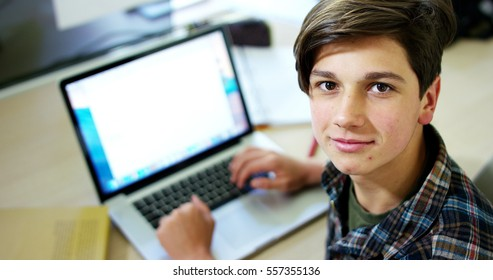 Young boy student, studying computer and is happy to learn new things