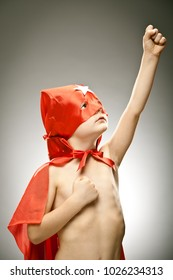 young boy superhero fly with cloak and mask portrait on grey background