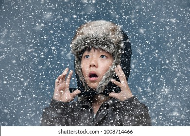 Young boy surprised by snow