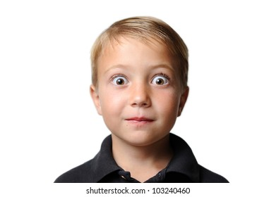 Young Boy with Surprised Look. Young boy with very large eyes appearing to be surprised. Isolated on a white background. Shallow depth of field.