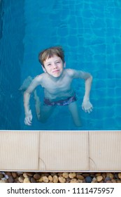 Young boy swimming.