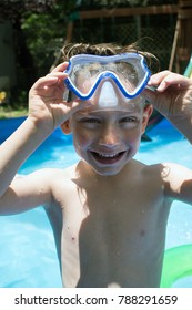 Young boy in swimming mask in swimming pool
