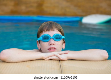 Young boy in the swimming pool.