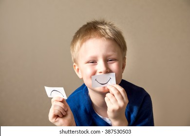 Young boy (teen) select between positive and negative expressions