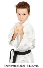 Young boy training karate. Isolated on white background