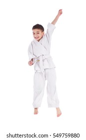 Young boy training karate isolated on white background