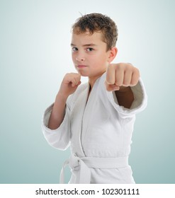 Young boy training karate. on green background