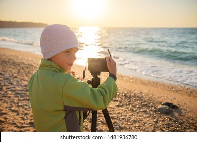 A young boy tries to learn and take photos.