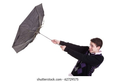 Young boy with an umbrella turned by the wind, isolated on white, studio shot