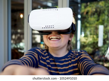 Young boy using VR goggles
