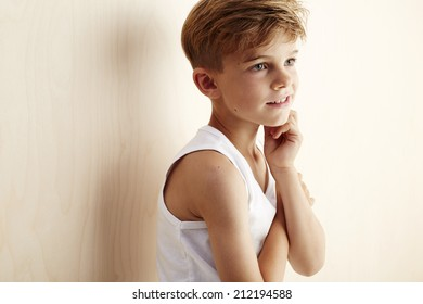 Young boy in vest looking away