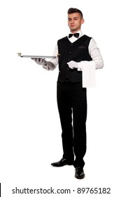 A young boy waiter with a tray. Isolated background and clipping path