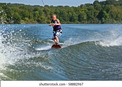 Young Boy Wakeboarding