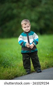 Young boy walking in the park. Portrait.
