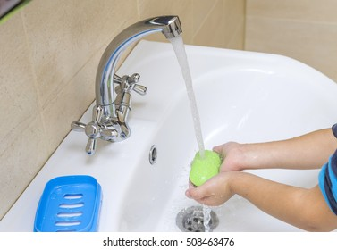 Young boy washing his hands with soap. Children's hygiene.