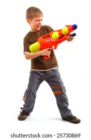 Young boy with water gun over white background.